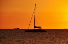 Orange sky and sailing boats