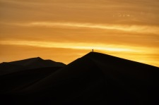 Lone man on the dunes of Huacachina